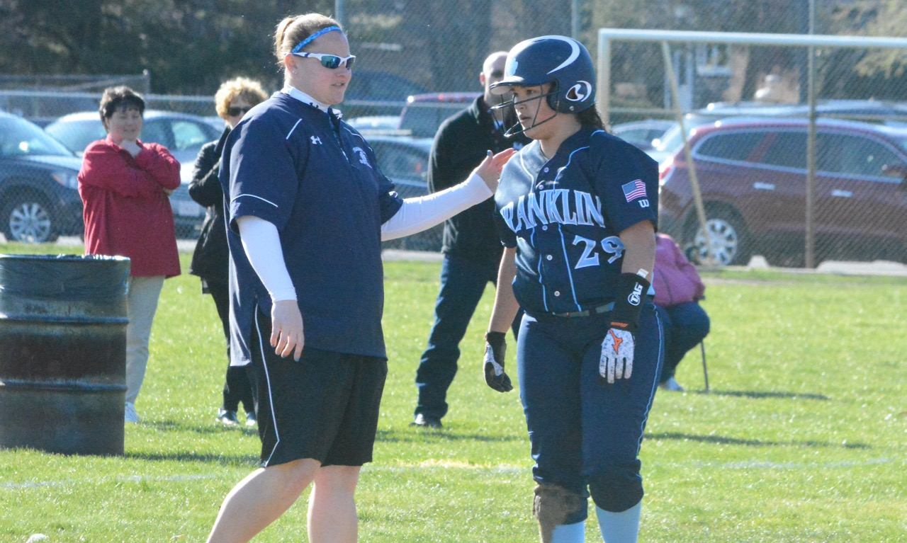 Junior catcher Clara DeCarvalho (29) gets congratulated by head coach Kate Fallon after her fifth inning triple. (Josh Perry/HockomockSports.com)